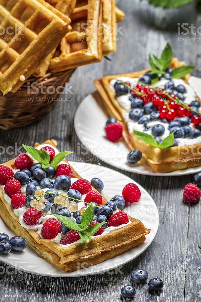 Waffles with fresh berry fruit and mint leaf royalty-free stock photo