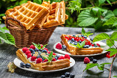 Waffles with fresh collected berry fruit.