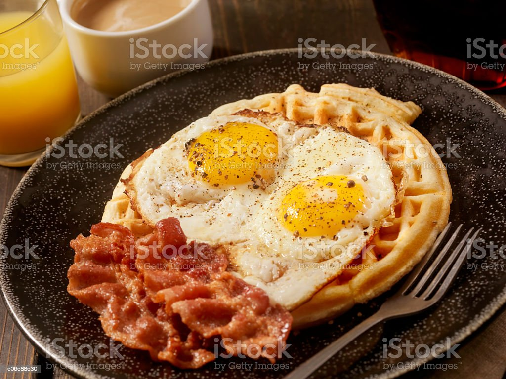 Waffles with Fried Eggs and Bacon stock photo