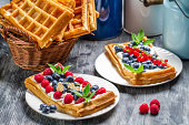 Waffles with fruit and whipped cream.