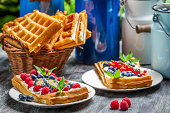 Waffles with fruit and whipped cream