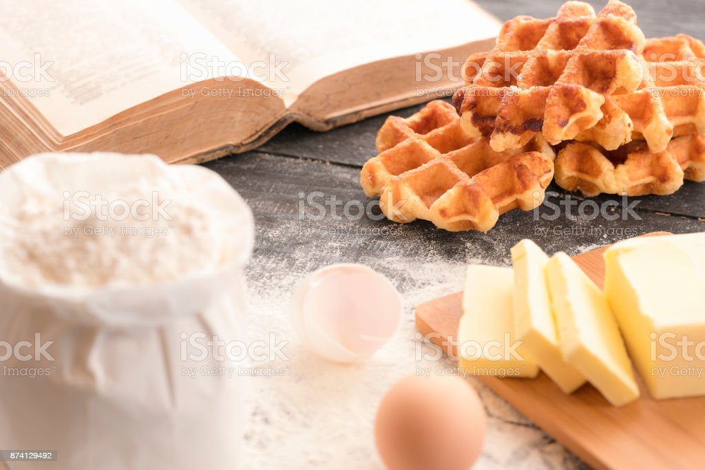 Waffles with ingredients and cookbook stock photo