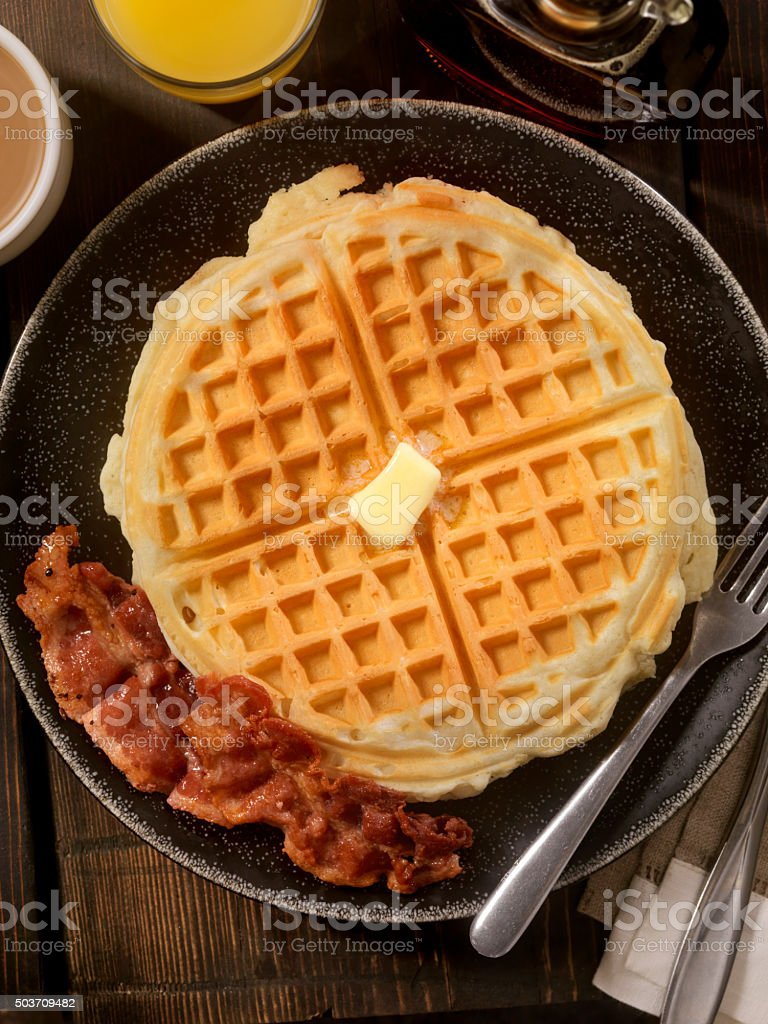 Waffles with Melting Butter and Bacon stock photo