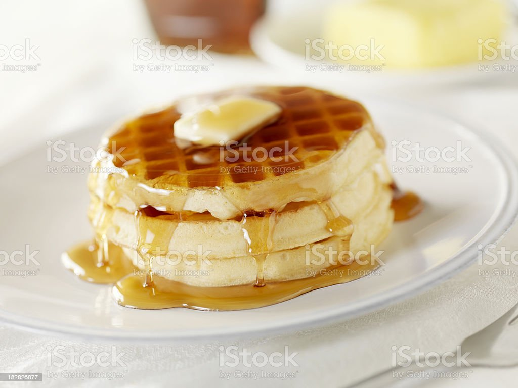 Waffles with Melting Butter and Maple Syrup stock photo