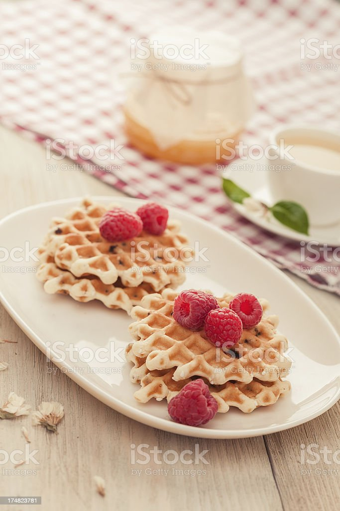 Waffles with raspberry and tea royalty-free stock photo
