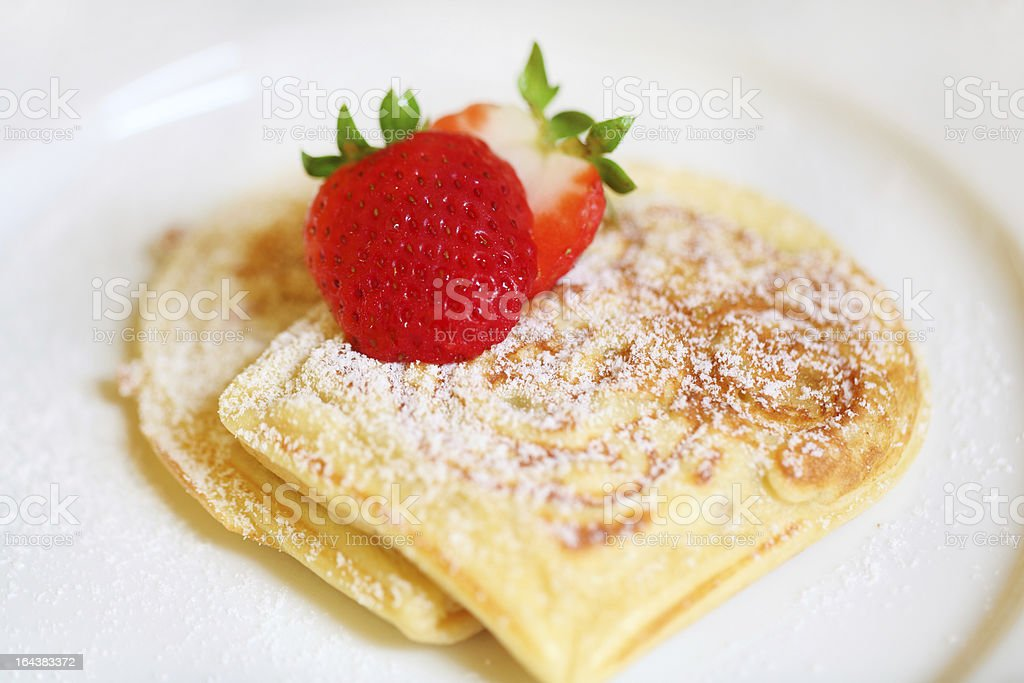 Waffles with strawberries and icing sugar royalty-free stock photo