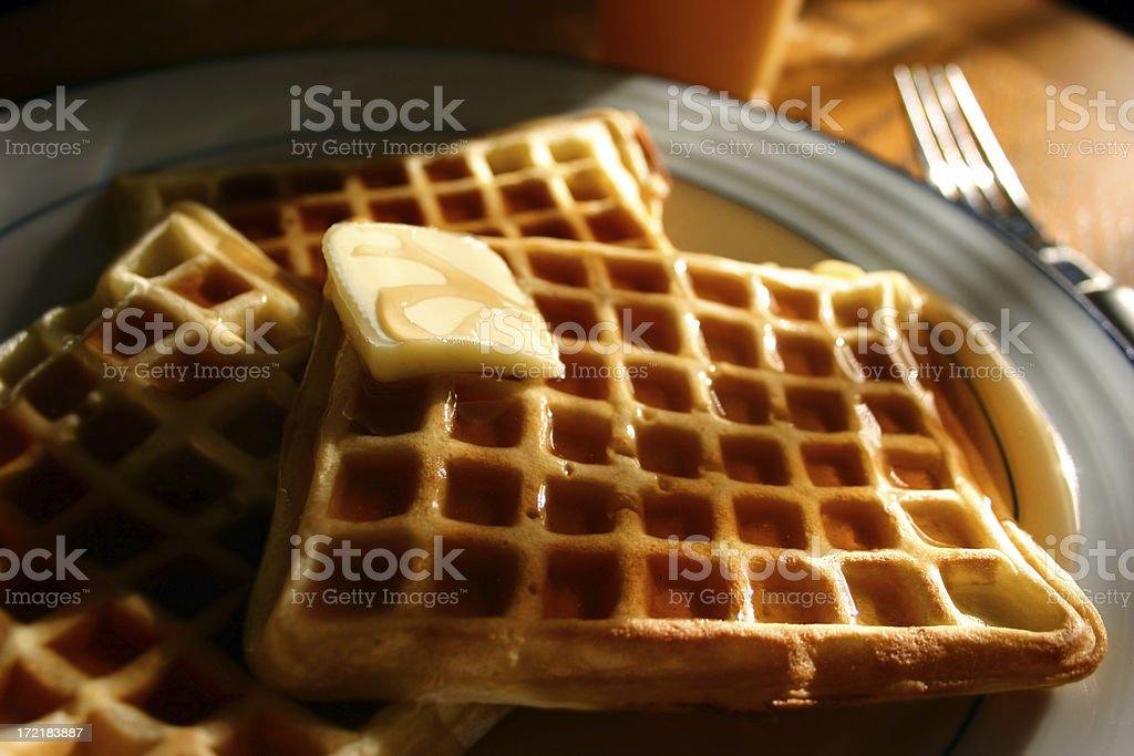 Waffles with syrup and butter on plate stock photo