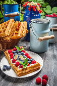 Waffles with whipped cream and fruit.