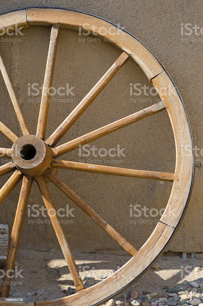 Wagon Wheel and Wall at Bent's Old Fort stock photo