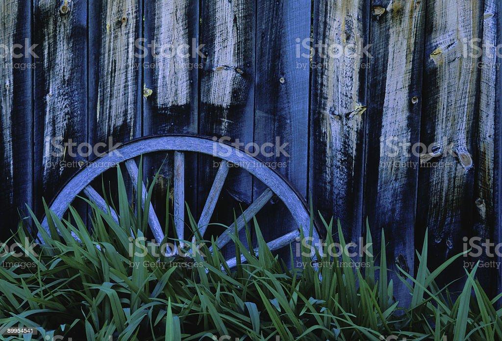 Wagon Wheel by Barn royalty-free stock photo