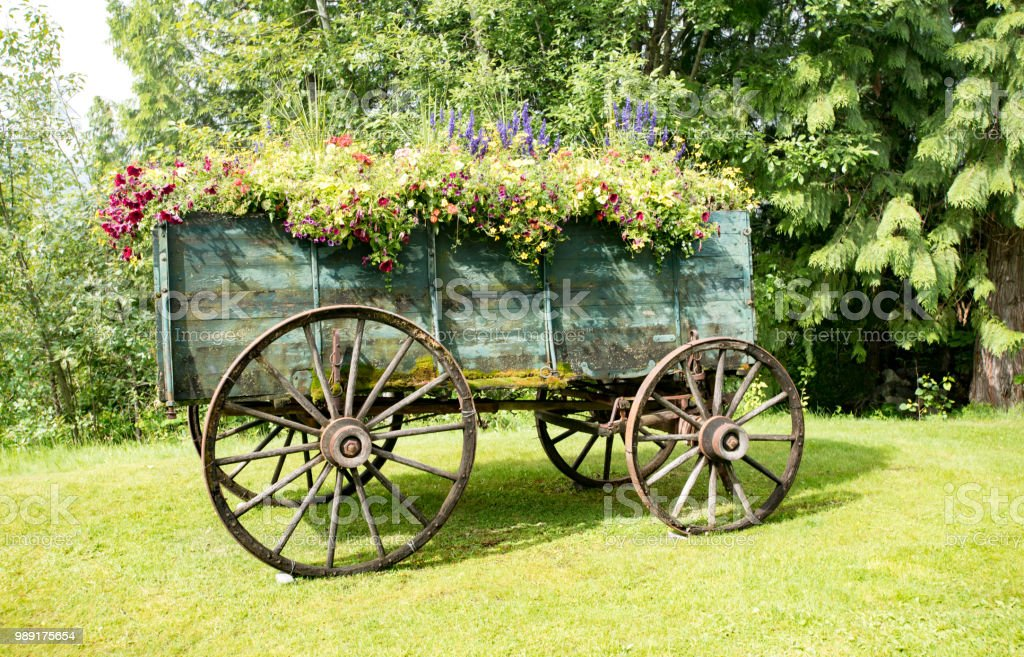 wagon with flowers on top stock photo