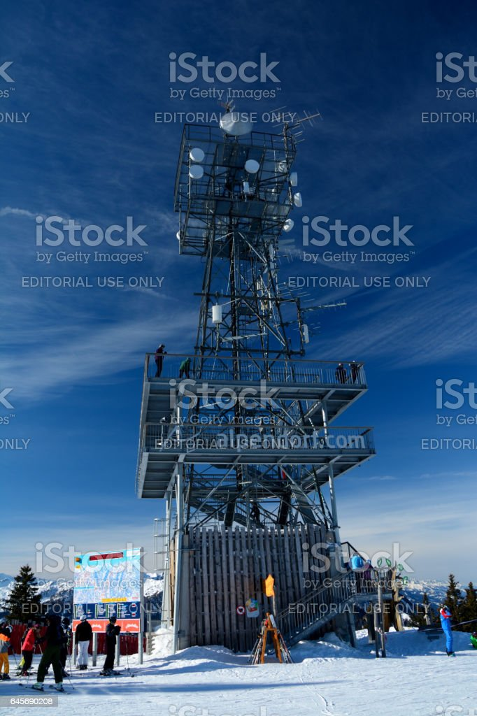 Wagrain, Austria - January 30 2017: Viewing  tower on top of mountain nearby Wagrain and Alpendorf in Alps in Austria. Unidentified people visible. stock photo