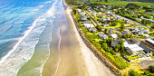 Holiday houses near the sandy beach at Waihi Beach, on the Coromandal Peninsula, in New Zealand's North Island.