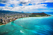 The beautiful coastline of the Waikiki area of Honolulu Hawaii shot from an altitude of about 1000 feet during a helicopter photo flight over the Pacific Ocean.