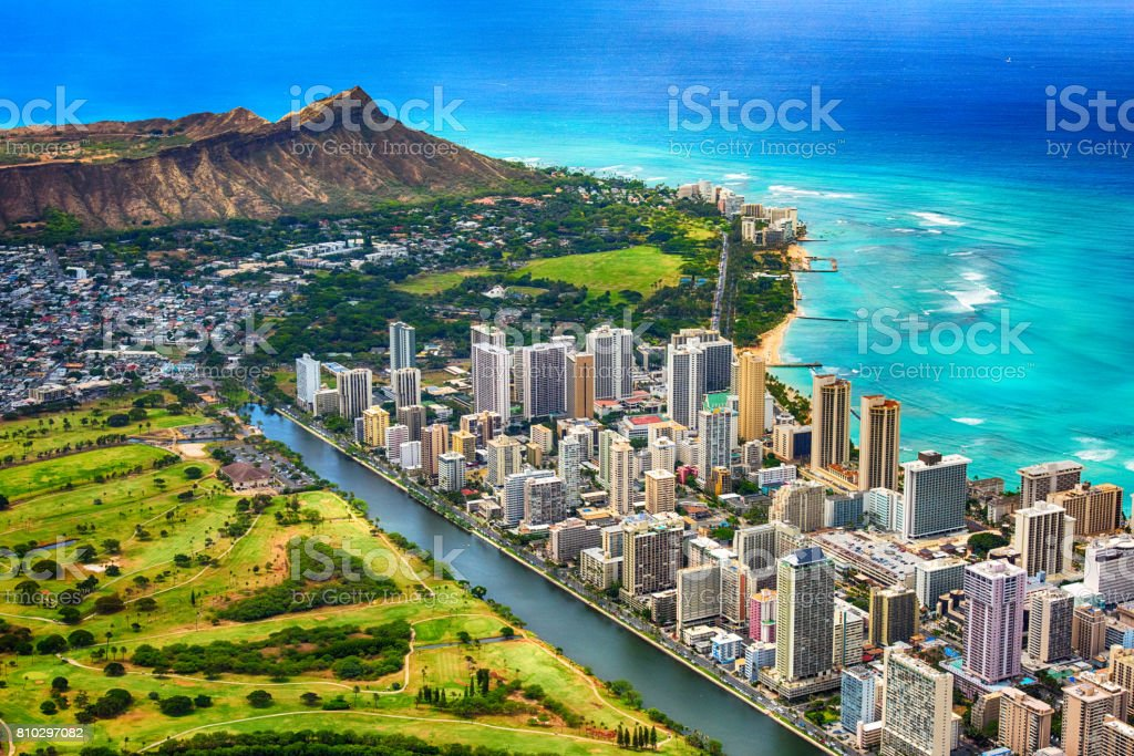 Waikiki and Diamond Head Aerial The beautiful coastline of the Waikiki area of Honolulu Hawaii with the volcanic crater, Diamond Head, in the background shot from an altitude of about 1000 feet during a helicopter photo flight over the island. Above Stock Photo