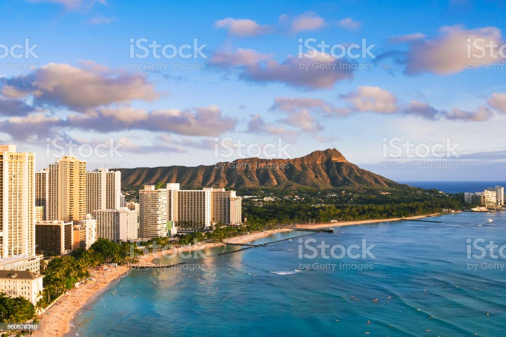 Waikiki Beach and Diamond Head Crater including the hotels and buildings in Waikiki, Honolulu, Oahu island, Hawaii. Waikiki Beach in the center of Honolulu has the largest number of visitors in Hawaii stock photo