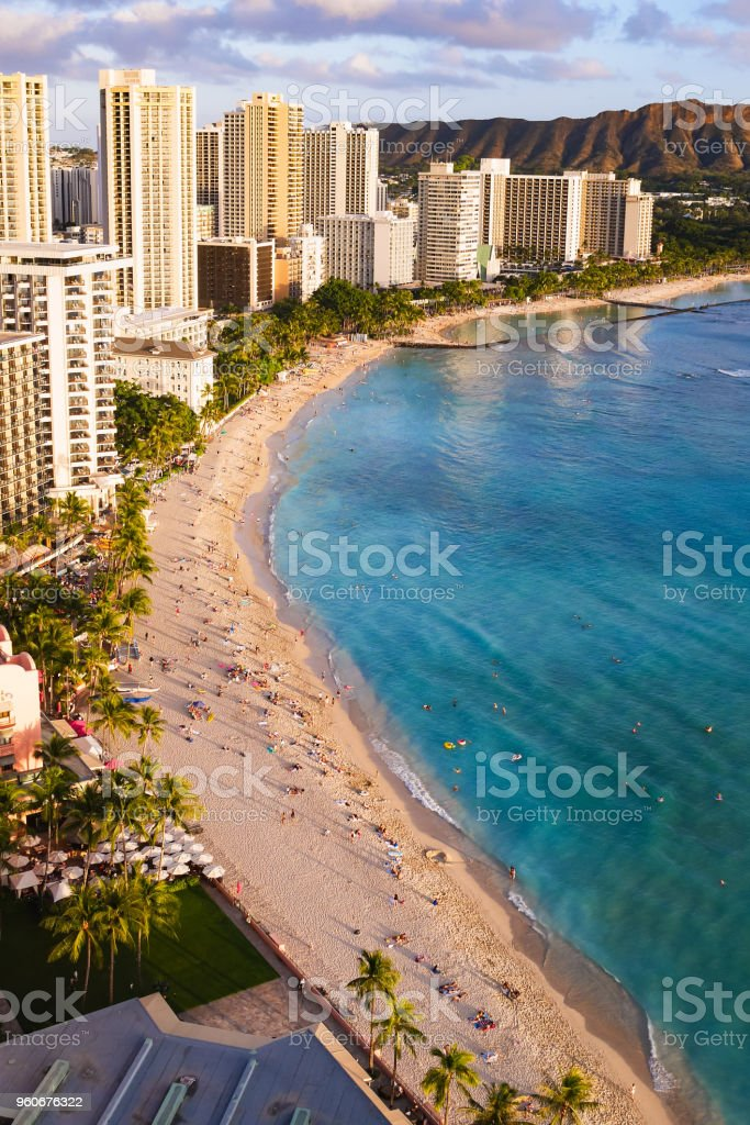 Waikiki Beach and Diamond Head Crater including the hotels in Waikiki, Honolulu, Oahu island, Hawaii, USA. Waikiki Beach in the center of Honolulu has the largest number of visitors in Hawaii. stock photo