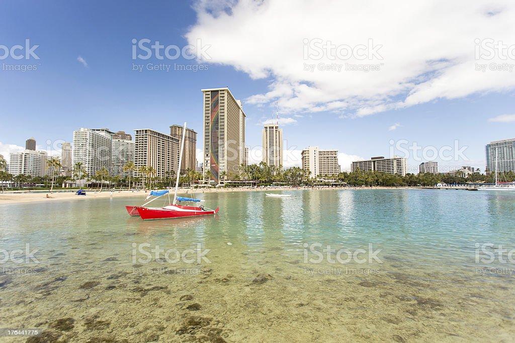 Waikiki beach and red sail boat royalty-free stock photo
