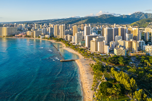 The beach, hotels, office towers and commercial buildings in Honolulu Hawaii.