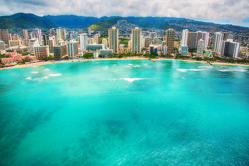The beautiful Waikiki Beach of Honolulu, Hawaii shot from an altitude of about 1000 feet over the Pacific Ocean.