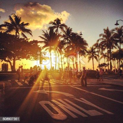 Waikiki beach sunset. people crossing street