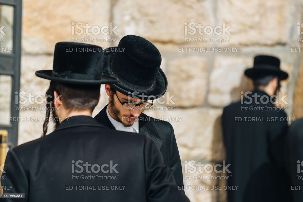 Wailing Wall and Jewish believers praying in front of the sacred place in Israel stock photo