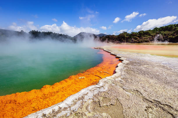 Waiotapu New Zealand Geothermal Champagne Pool Colorful orange - green Champagne Pool in the Waiotapu Thermal Wonderland. The pool is a 65 m wide spring, containing multiple minerals that are presently depositing in the surrounding sinter ledge. Waiotapu, North Island, New Zealand. rotorua stock pictures, royalty-free photos & images