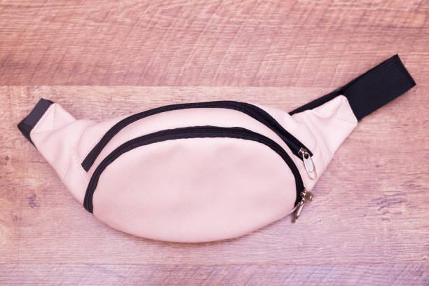 waist bag of banana of beige colour - waist bag stock photos and pictures
