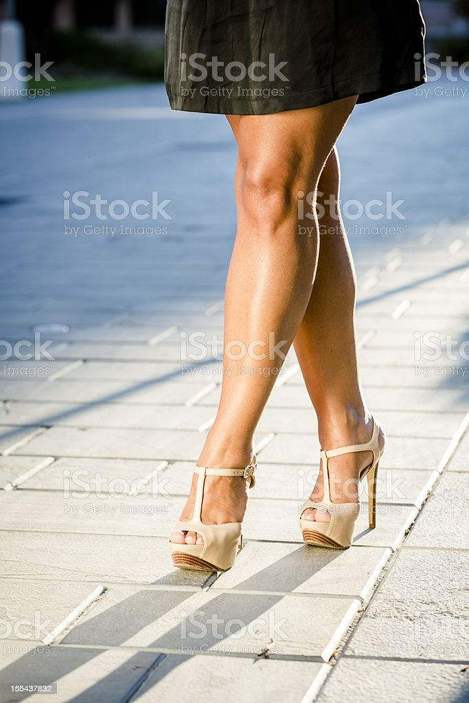 Waist Down of Woman Wearing High Heels