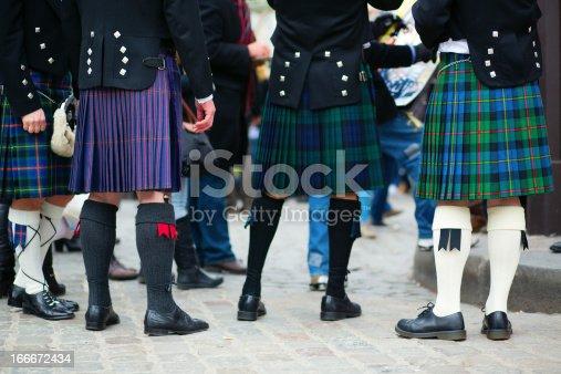 Men in traditional kilts