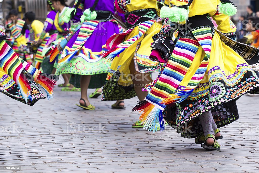 Waist down view of Peruvian dancers at a parade in Cusco stock photo