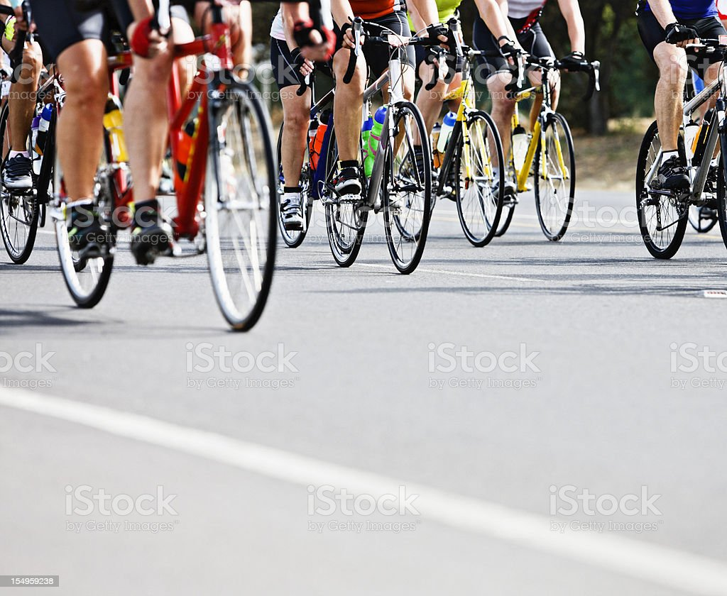 Waist  down view of racing cyclists in pack stock photo