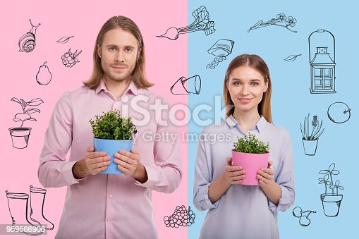 istock Waist up of gorgeous couple with plants 959566906