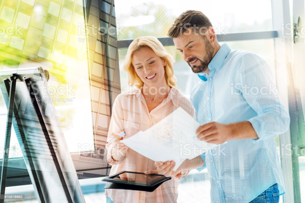 Waist up of successful project managers at work stock photo