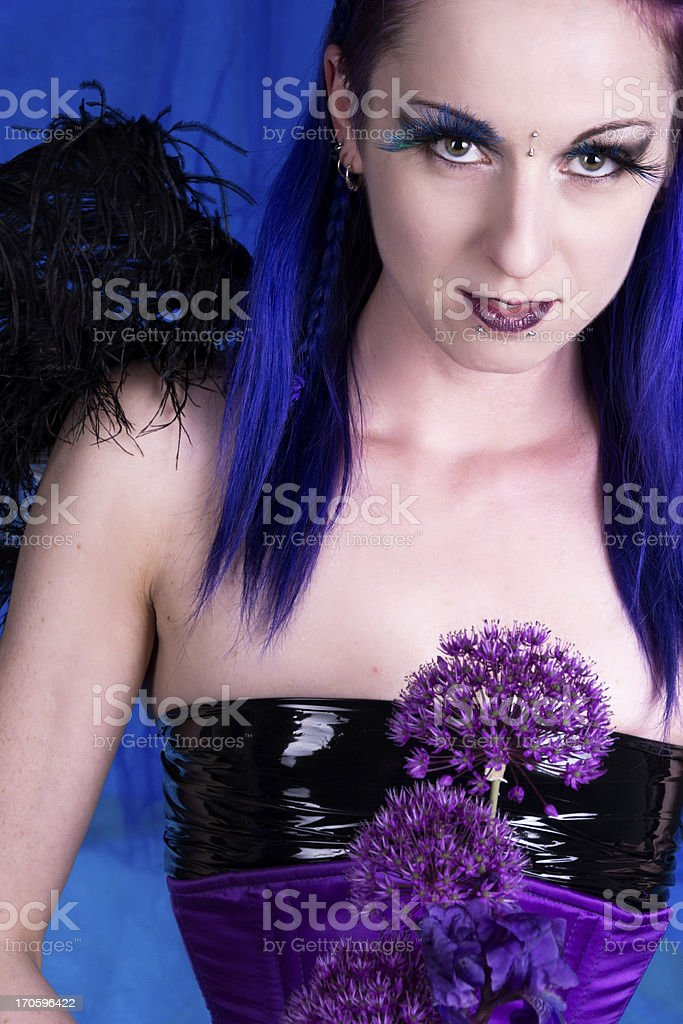 Waist up of winged woman holding flowers. stock photo