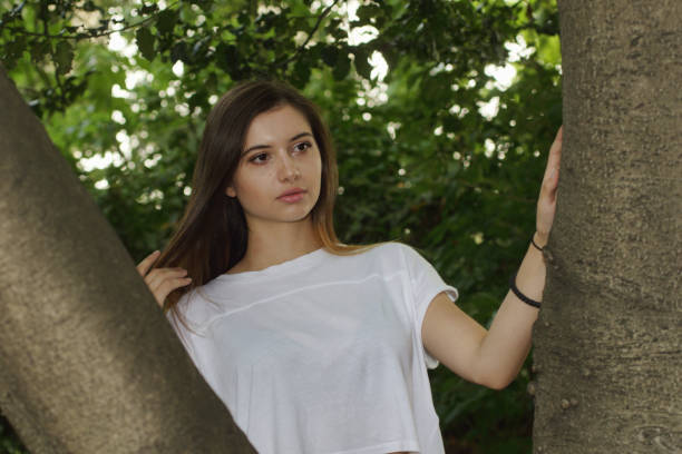 waist up portrait bulgarian outdoor girl beauty in woodland - whiteway bulgarian outdoor girl stock photos and pictures