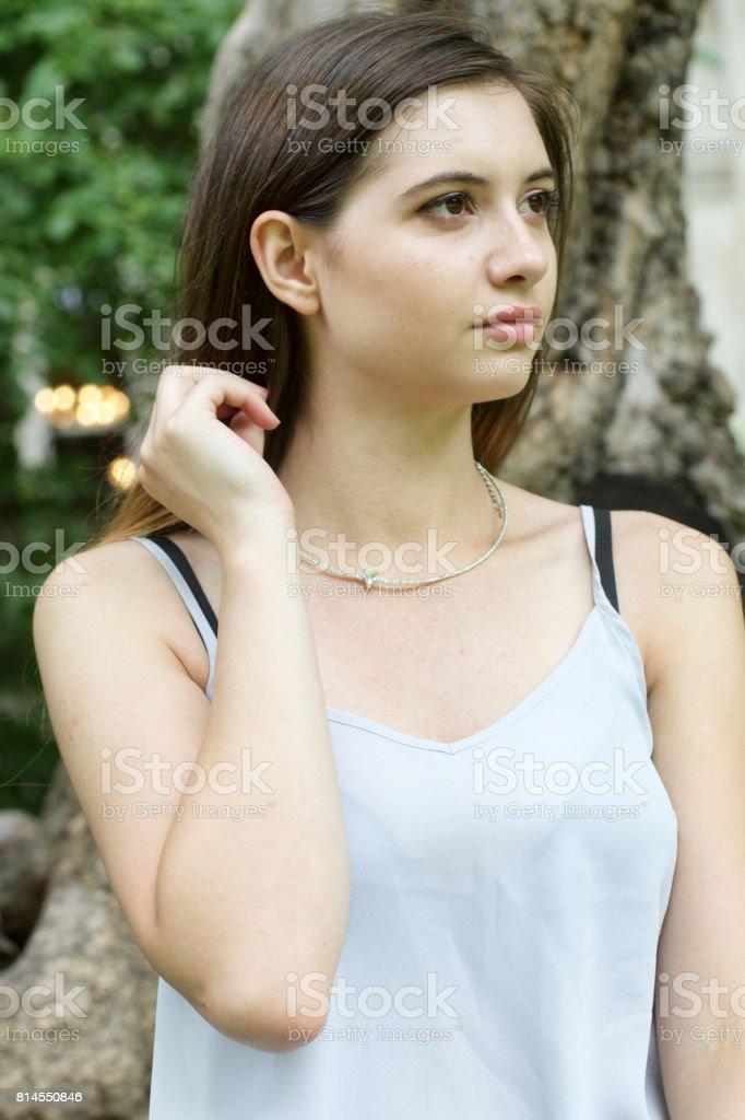Waist up portrait Bulgarian outdoor girl beauty in woodland stock photo