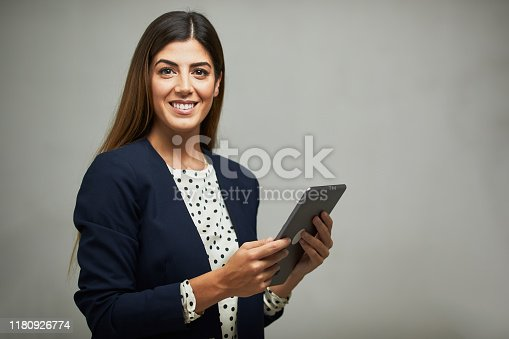 1126471588 istock photo Waist up portrait of a businesswoman holding a digital tablet. 1180926774