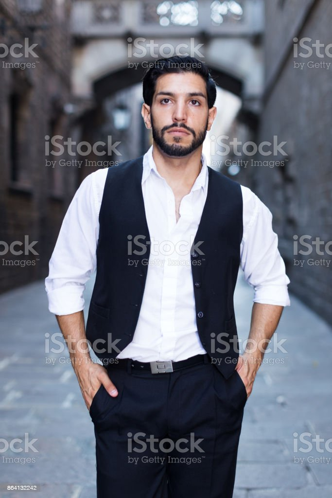 Waist up portrait of man at ancient street royalty-free stock photo