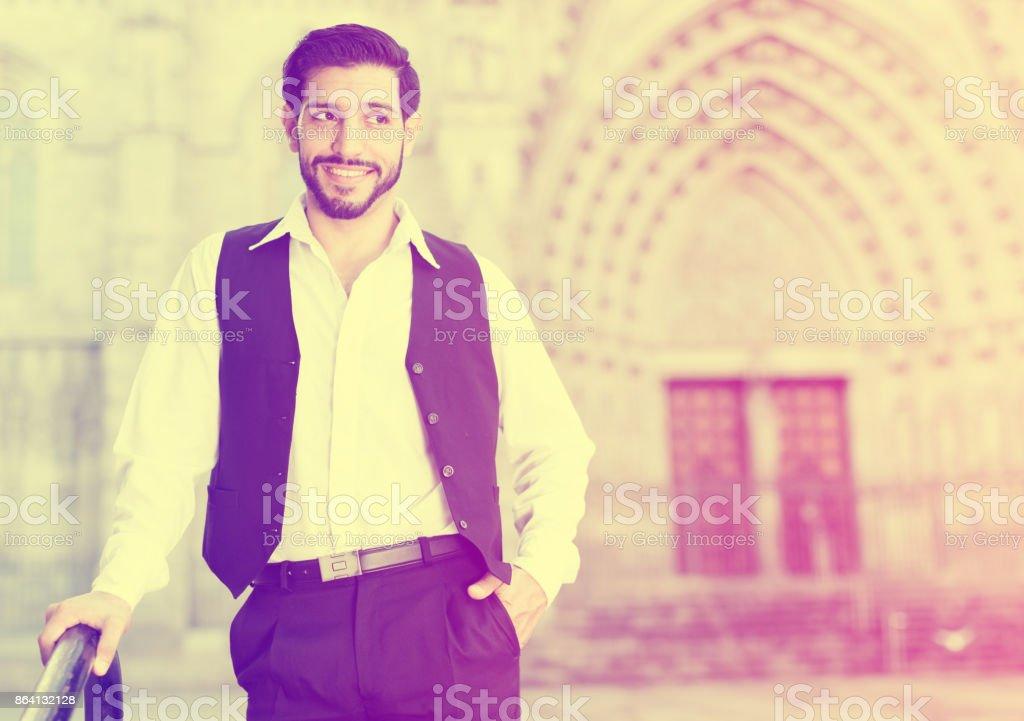Waist up portrait of man near iron banisters royalty-free stock photo