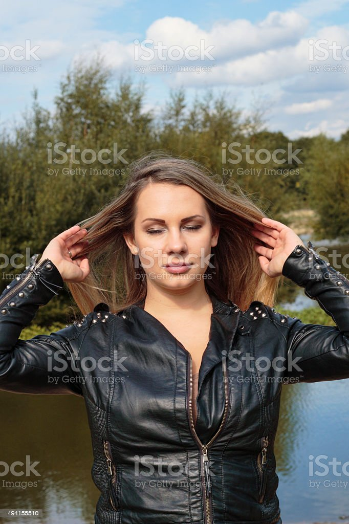 Blonde woman tossing back long hair outdoor Polish girl stock photo