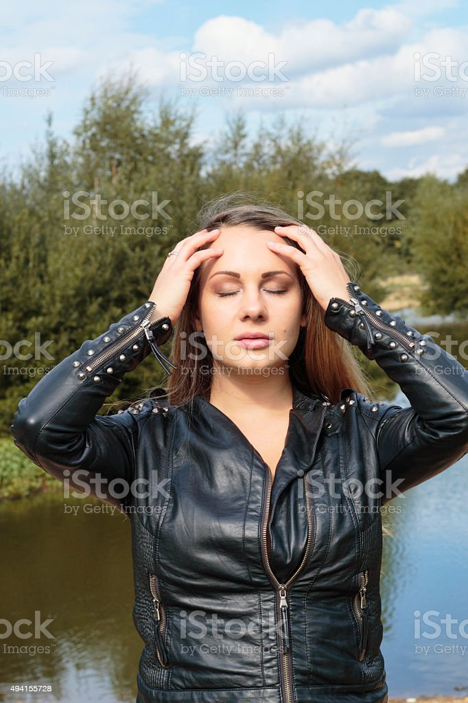 Anxiety woman with hands on head outdoor Polish girl stock photo