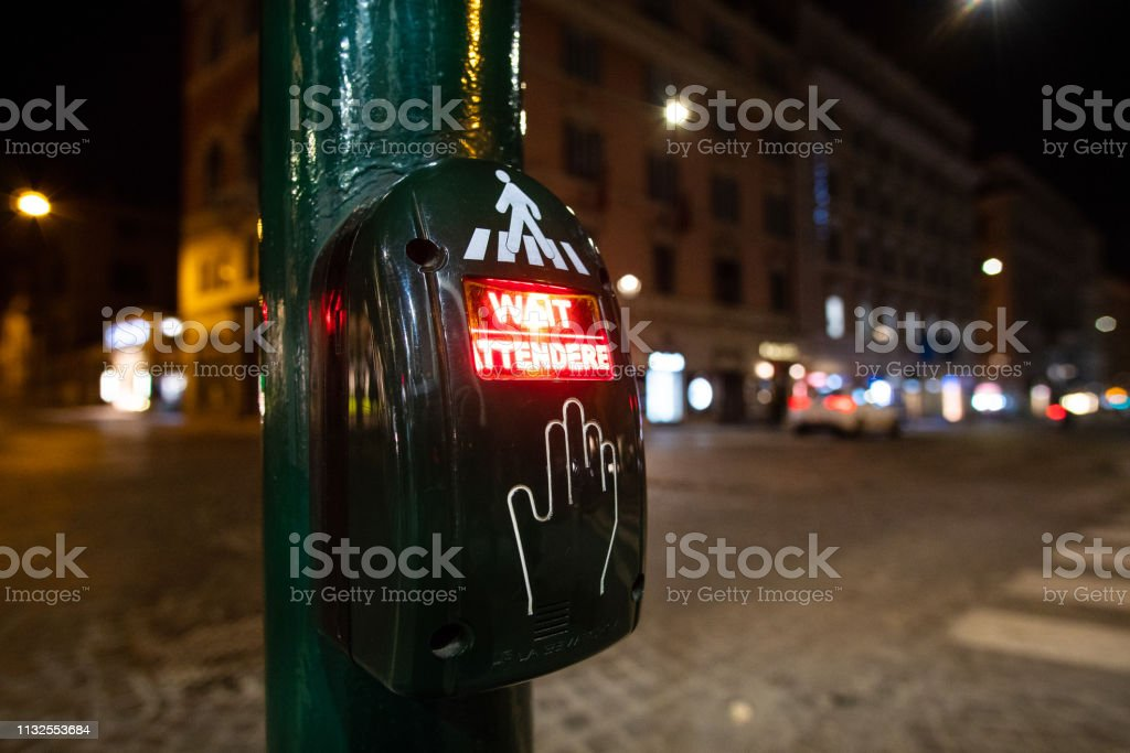 Wait sign traffic light on pedestrian crossing during the night