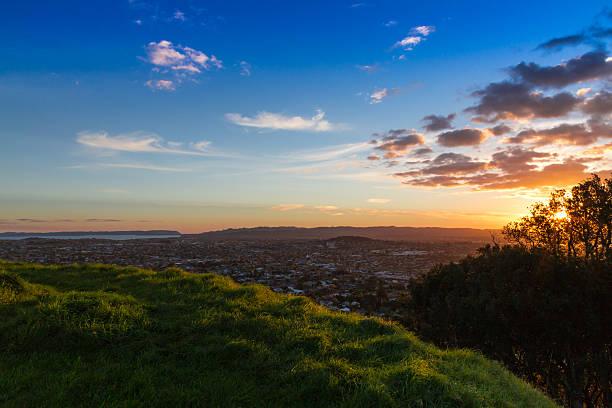 Waitakere Ranges at sunset stock photo