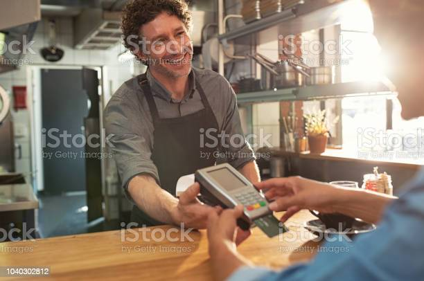 Waiter accepting payment by card picture id1040302812?b=1&k=6&m=1040302812&s=612x612&h=zpw9arw8 erl8lo1d6uairwcwditovadwzy95gvcpii=