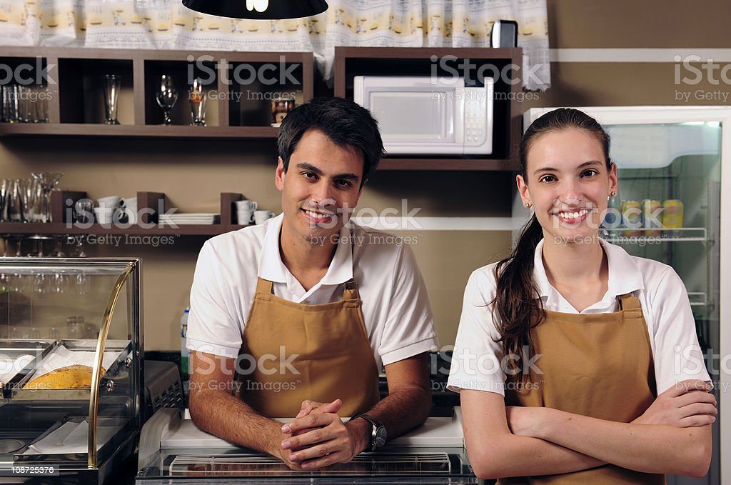 Waiter and waitress at a cafe royalty-free stock photo