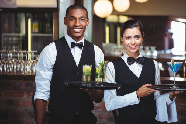 Best Waiter Stock Photos, Pictures & Royalty-Free Images