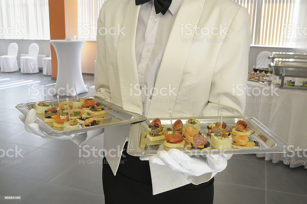 Waiter at a meeting of visitors. royalty-free stock photo