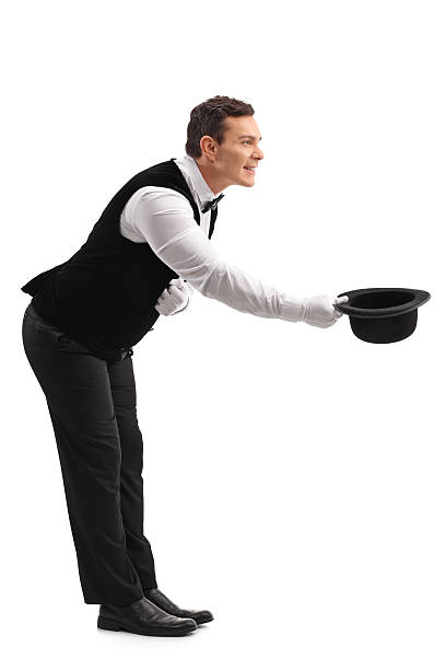 Waiter bow down and taking off his hat stock photo