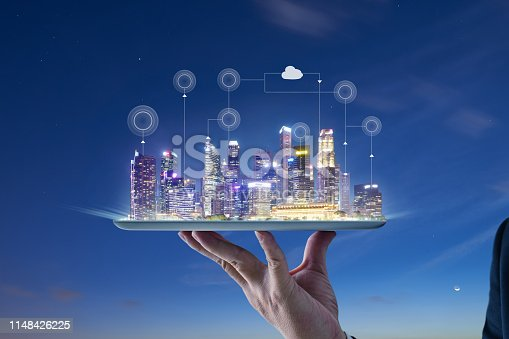 istock Waiter hand holding an digital tablet with Smart city 1148426225